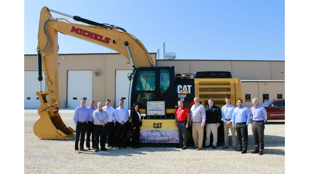 Michels receives the 10,000th machine to be produced at Caterpillar's Victoria, Texas facility. Present at the ceremony were Tyler Sternat (Fabick Cat), Kent Podobinski (Caterpillar), Chuck Riggert (Caterpillar), Art Strother (Victoria facility manager), Doug Fabick (Fabick Cat), Mary Morris (Victoria O&D Planning), Kevin Michels, Pat Michels and Terry Gassner (MICHELS Corporation), Adam Helleberg (PLM), Roger Montalvan (Victoria supply chain manager), and Craig McArton (Fabick Cat).