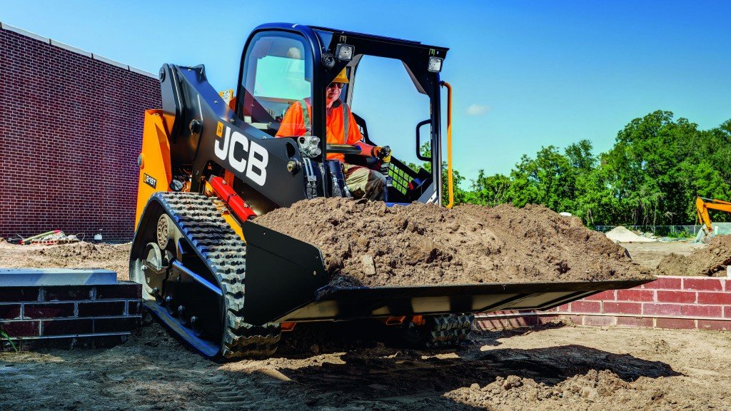 A JCB CTL carries dirt