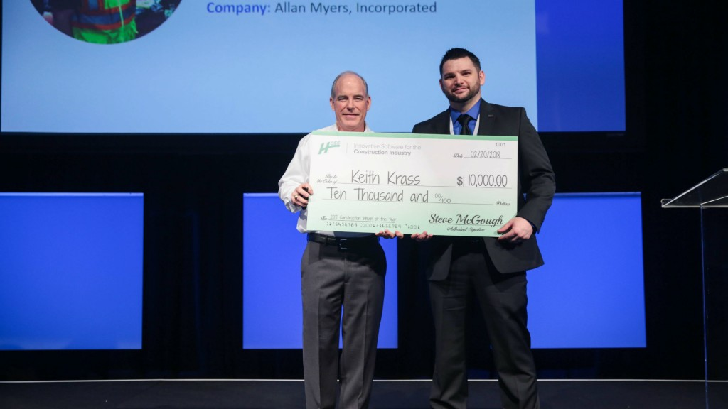 2017 Intern of the Year Keith Krass (right) receives a $10,000 scholarship from HCSS CFO Steve McGough.