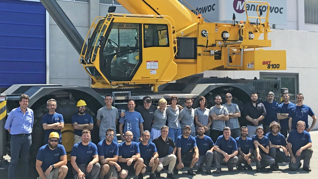 The team from Manitowoc's Italian factory celebrate the completion of the first Grove GRT8100 from their facility.
