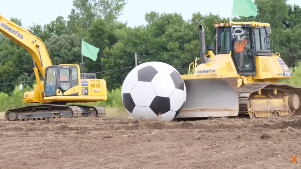 Watch this: Extreme Sandbox takes Komatsu equipment to the pitch for game of extreme soccer