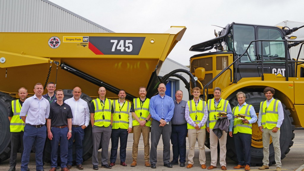 Representatives of Caterpillar, Trader Construction Company and Gregory Poole Cat marked the delivery of the 50,000th articulated truck from Cat's Peterlee, UK facility.