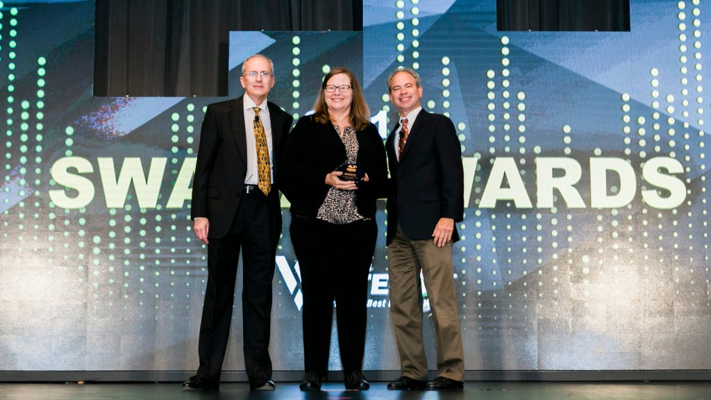 Elizabeth Roe (centre) President of Eco Partners, was among this week's award recipients at SWANA's Wastecon 2018.