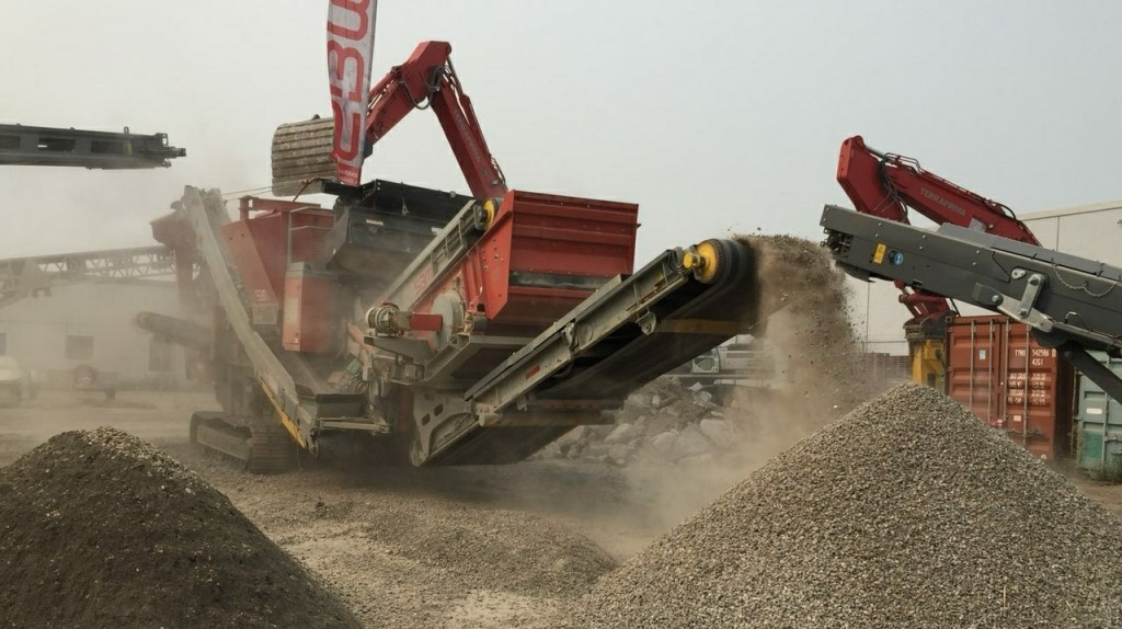 An SBM Remax 1312 mobile impact crusher  in action crushing recycled concrete.