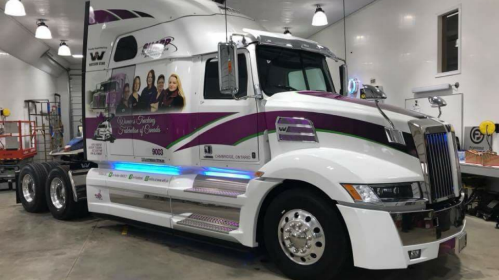 Western Star bearing pictures of Women's Trucking Federation of Canada members wins graphic award