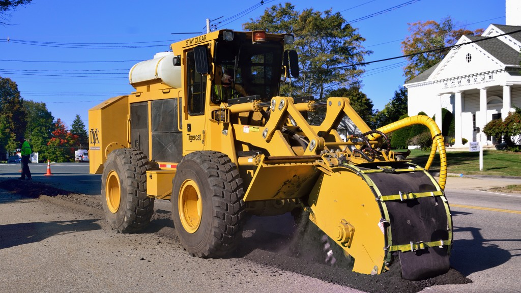 Tigercat street trencher cuts, pulverizes and fills in one pass