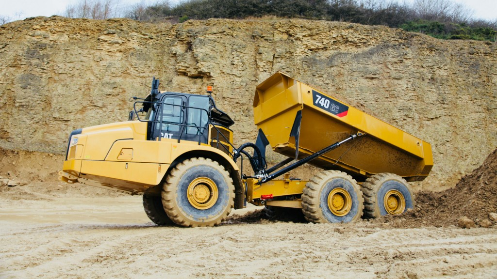 The standard Cat Detect/Stability-Assist system monitors the working angle of the tractor and body, as well as the grade, and cautions the operator if the machine is approaching a set threshold angle, stopping the dump process if continued action might potentially result in tipping.