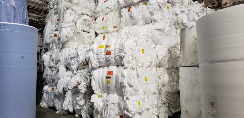 Baled nonwoven material ready for repurposing.