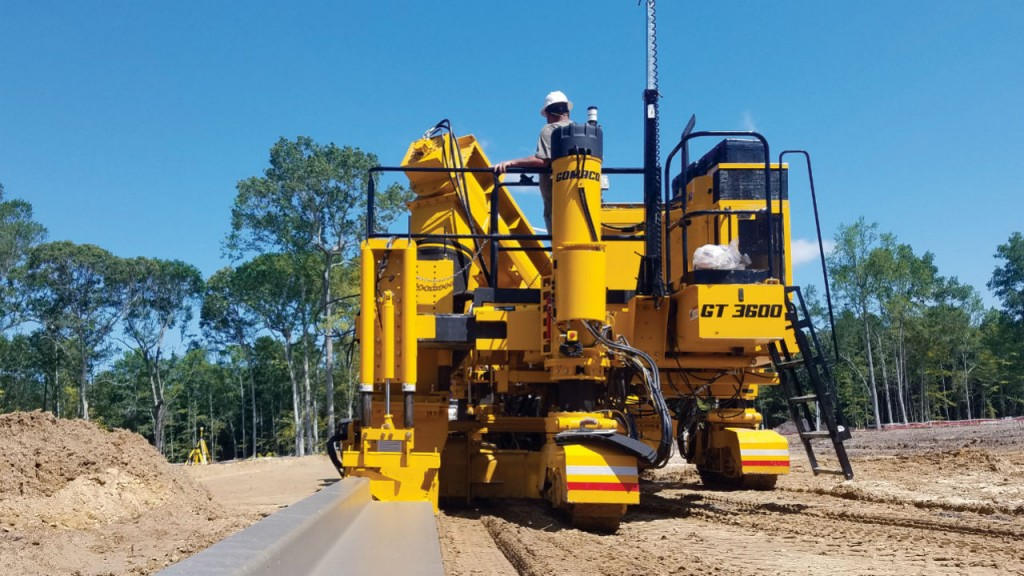 The first three-track slipform curb and gutter machine to slipform a 24-inch (610-mm) radius now features GOMACO's Xtreme Radius program for tight radii on stringline.