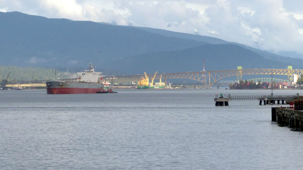 A tanker passes through Vancouver harbour from Burrard Inlet.