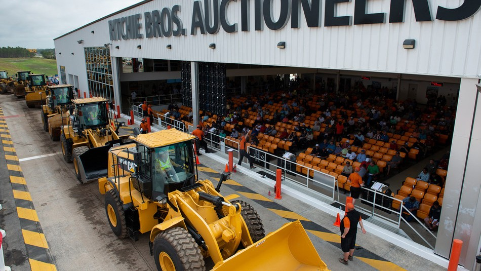 More than 430 loaders were sold in Ritchie Bros.' record-breaking Orlando, FL auction last week. (CNW Group/Ritchie Bros. Auctioneers).