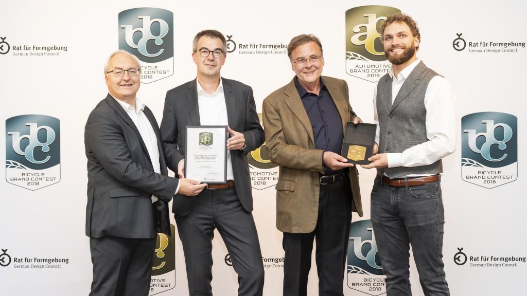 "At the Automotive Brand Contest 2018 prize giving ceremony in Paris on 2 October during the ""Mondial de l'Automobile"" trade fair: Gottfried Beer, Dr. Axel Römer (both HAMM), Ulrich Ewringmann, Julius Renz (both Dialogform)."