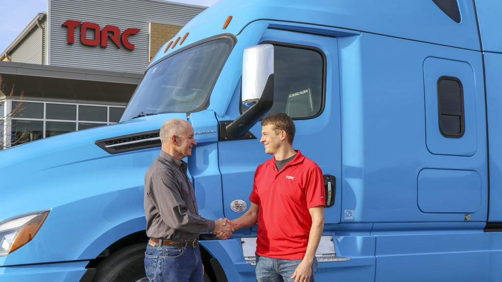 Daimler Trucks North America CEO, Roger Nielsen (left), shakes hands with Torc CEO, Michael Fleming.