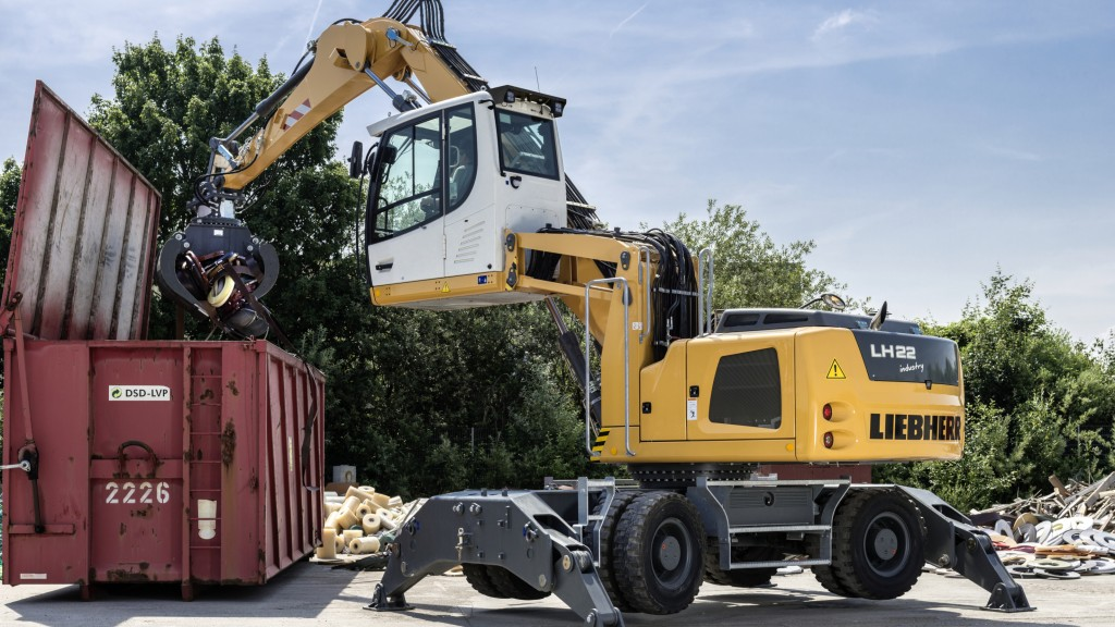 A Liebherr LH 22M material handler loading a container.