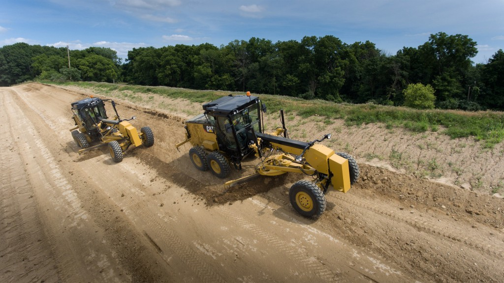 It is easy to tell the difference between the Cat 120 motor grader with joystick controls (left) and wheel/lever controls (right) as they have different cab designs.
