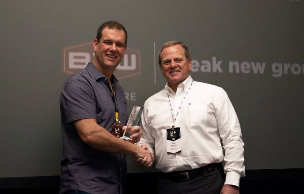 Bob Brown, right, president of B2W Software presents the B2W Software 2019 Client Innovation Award for Best Use of the B2W ONE Platform to Ryan Priestly, president of Priestly Demolition.