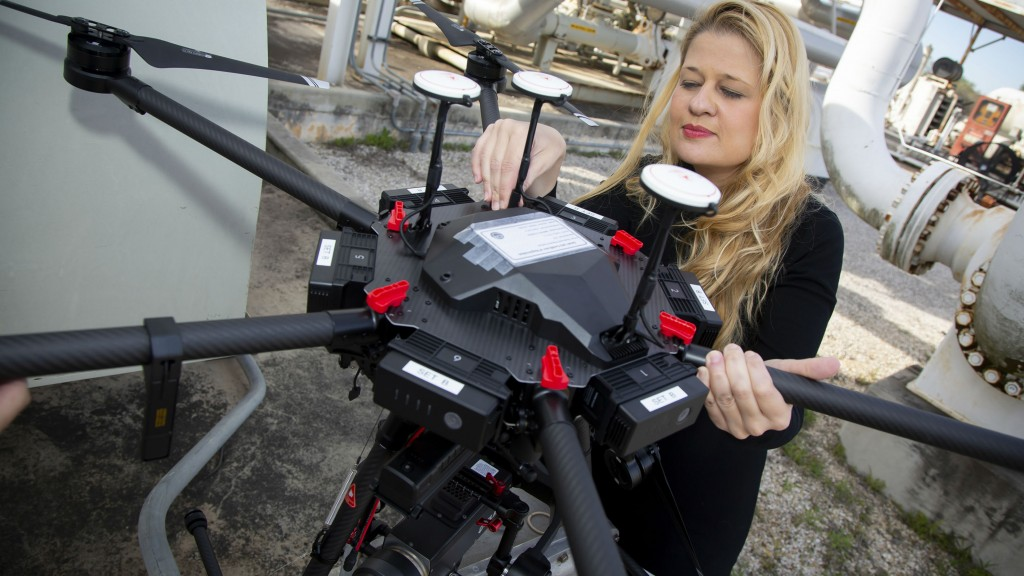 Maria Araujo inspects a drone that uses midwave infrared cameras (MWIR) to autonomously detect methane leaks. SwRI's Smart LEak Detection System (SLED) uses computer vision and machine learning to detect pipeline leaks from aerial drones.