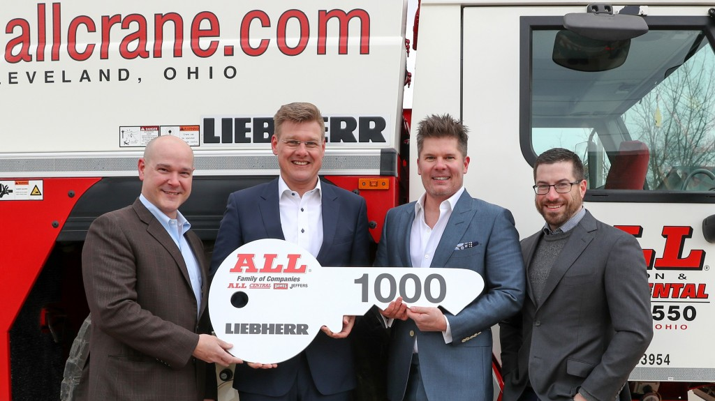 Members of the Liebherr and All Crane team recently celebrated the handover of the 1,000th LTM 1200-5.1. From left are Brian Peretin, Liebherr's general manager of sales for mobile and crawler cranes; Reinhold Breitenmoser, regional sales manager for Liebherr Werk, Ehingen, Germany; Michael Liptak, CEO and president of ALL Crane; Lawrence Liptak, corporate controller, ALL Crane.