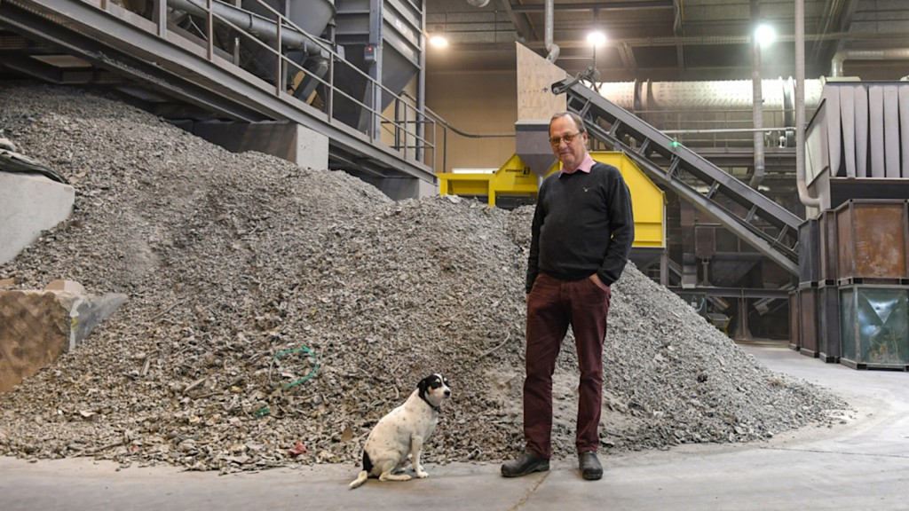 "Ejvind Pedersen, CEO of Scanmetals S/A in Denmark, with his companion ""Tiger"" in front of their Steinert induction sorting system."