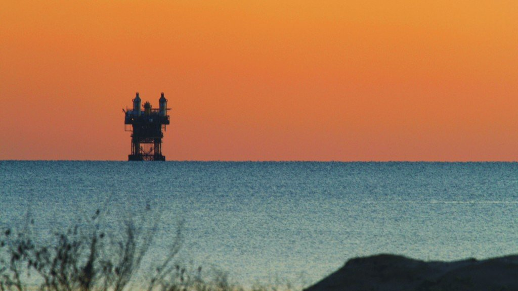 Offshore drilling rig off in the distance.