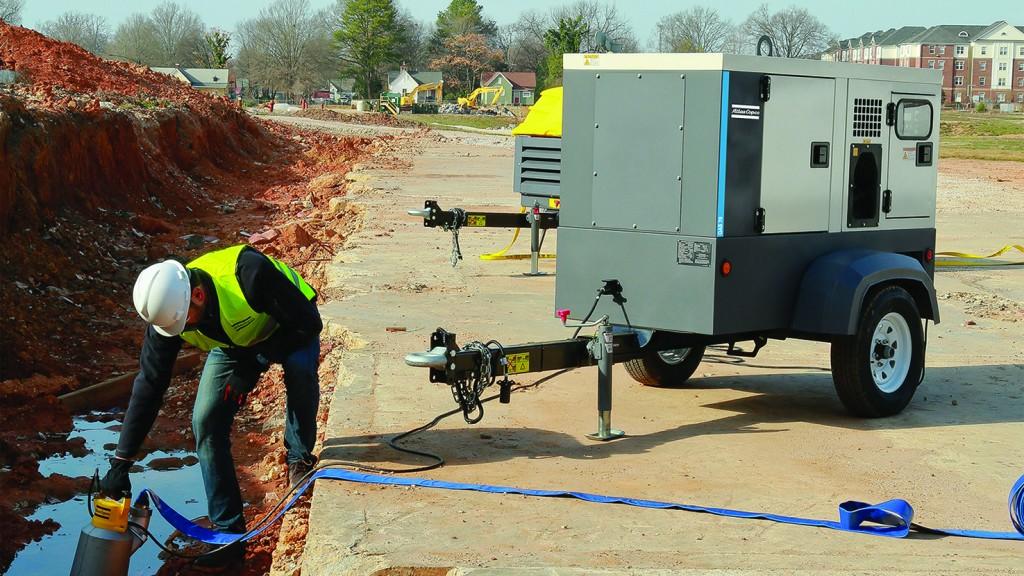 An Atlas Copco generator powers a pump.