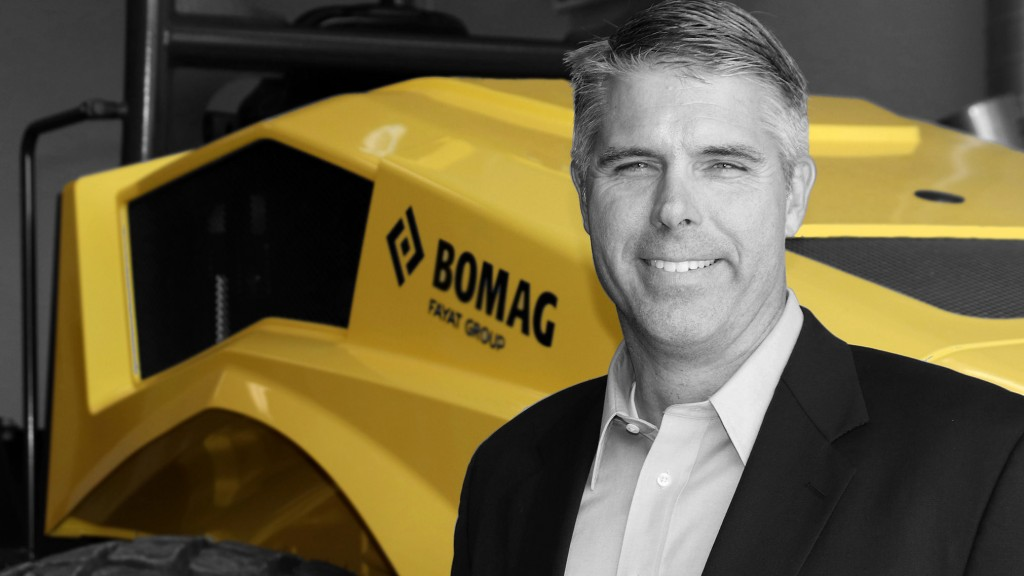 Man standing in front of Bomag machine.