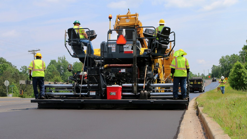 A bomag paver in action on a road
