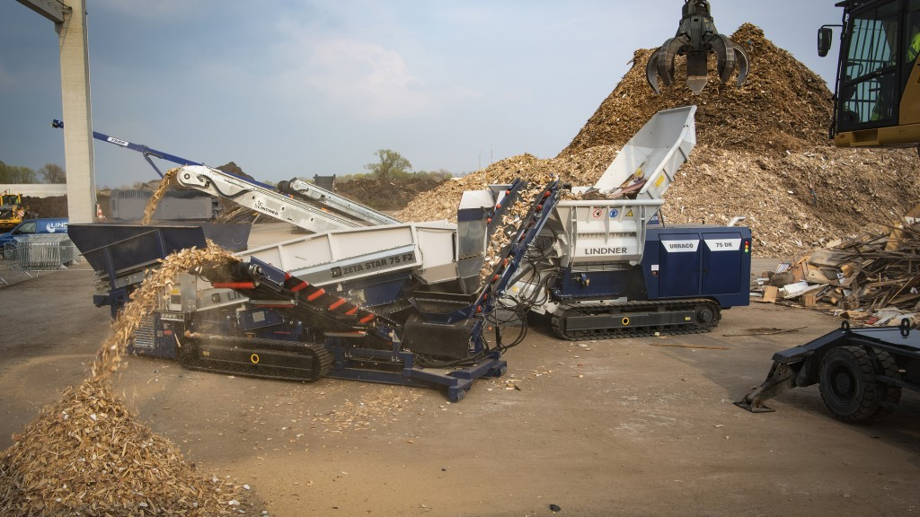 Two construction machines shooting out material