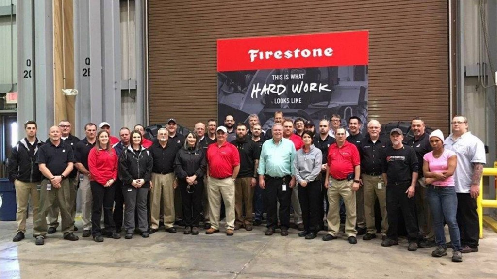Firestone wrokers pose for picture