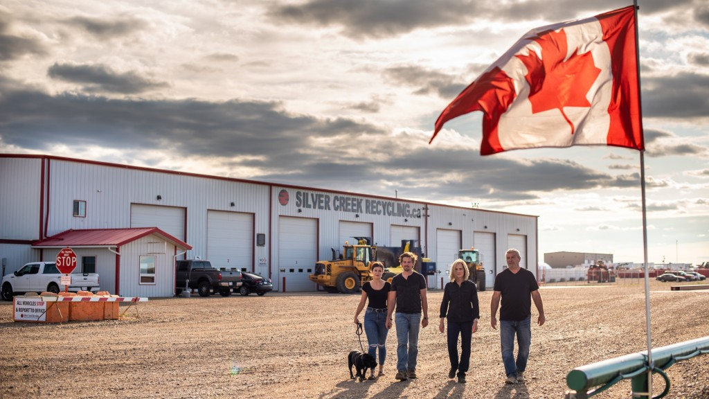 The Lubas outside their Redcliff, Alberta, scrap and auto recycling facility. From left: Merl (the dog), Amanda, Bradyn, Twila and Danny.