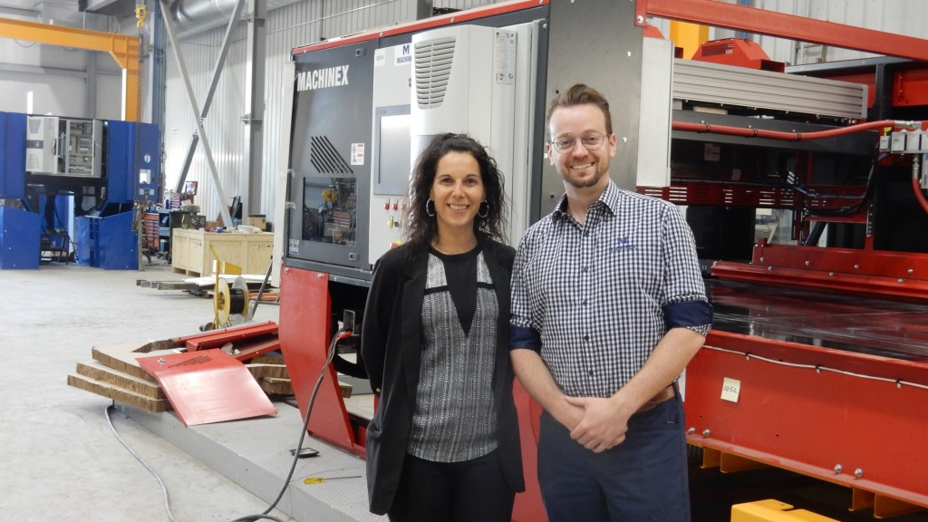 Machinex' Karine Moreau, director of communications, and Jonathan Ménard, Eng., project director, on the factory floor with an optical sorter in production, in Plessisville, Quebec.
