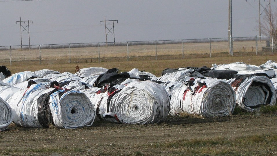 Rolled grain bags at a Saskatchewan Cleanfarms collection site ready to go to an end market to be washed, shredded and pelletized, and then recycled into new plastic bags.