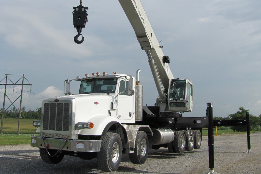 New National Crane boom truck from Manitowoc features long boom, high capacity