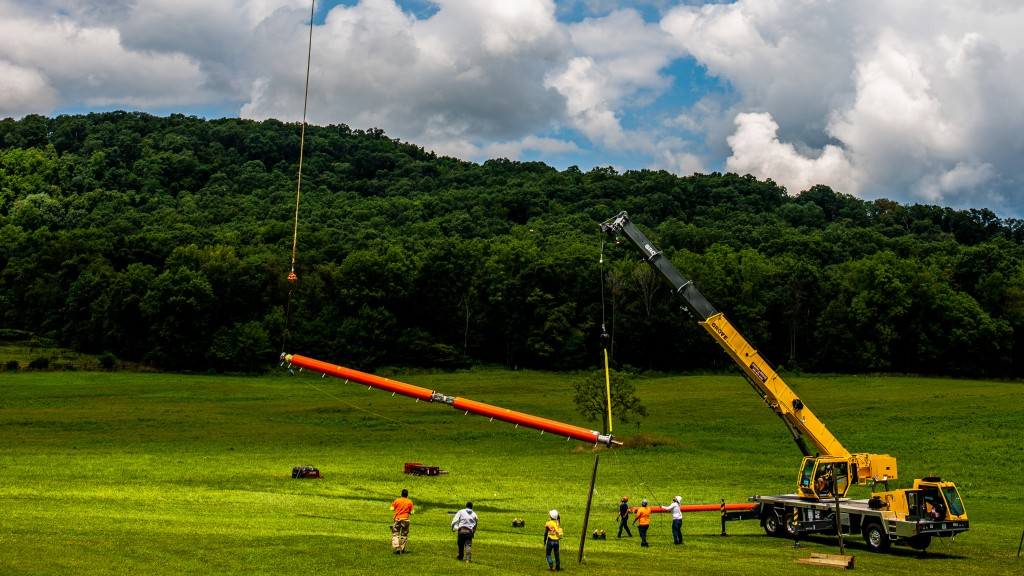 Grove crane teams up with helicopter to install antenna on radio tower