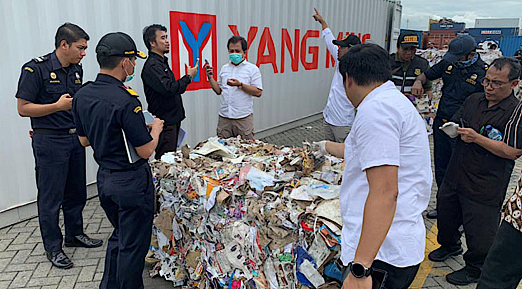 Indonesian customs officials examining seized paper waste imports contaminated with plastics and hazardous wastes. Photo by Prigi Arisandi, Ecoton 2019.
