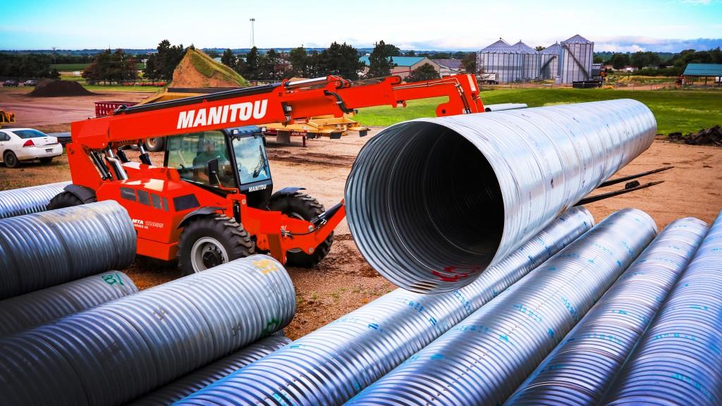 Manitou mta 12055 telehandler picking up steel tubing