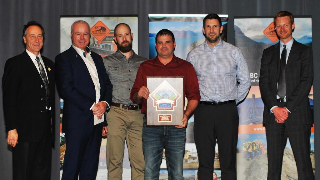 award winners accept plaque