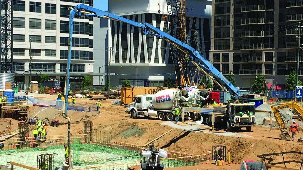 Putzmeister boom on building site.