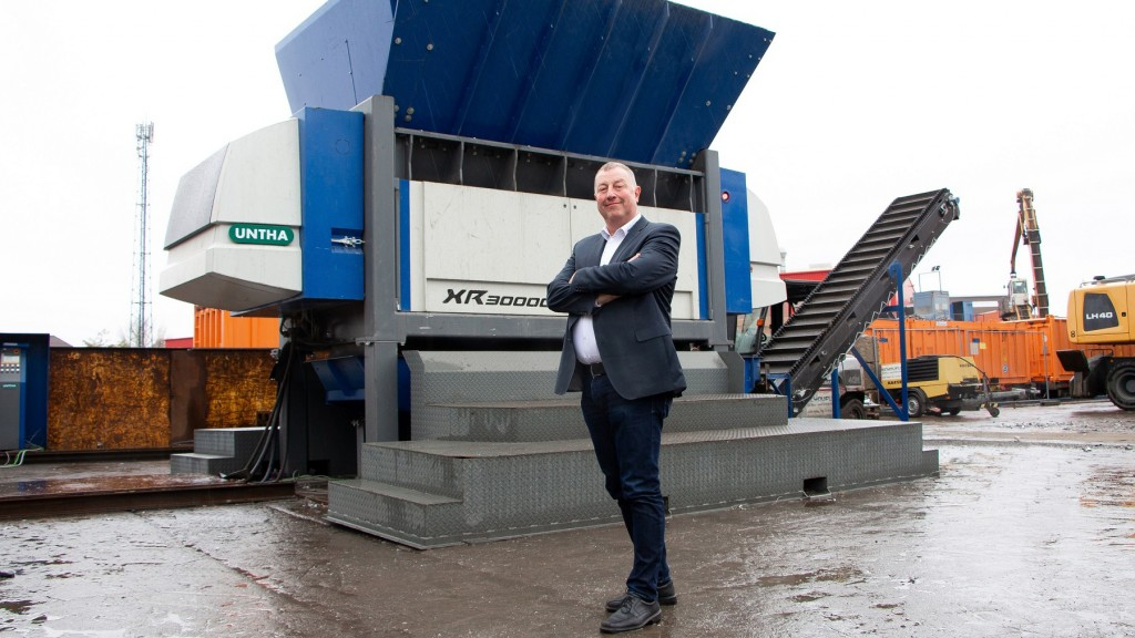 man stands in front of Untha XR3000 shredder
