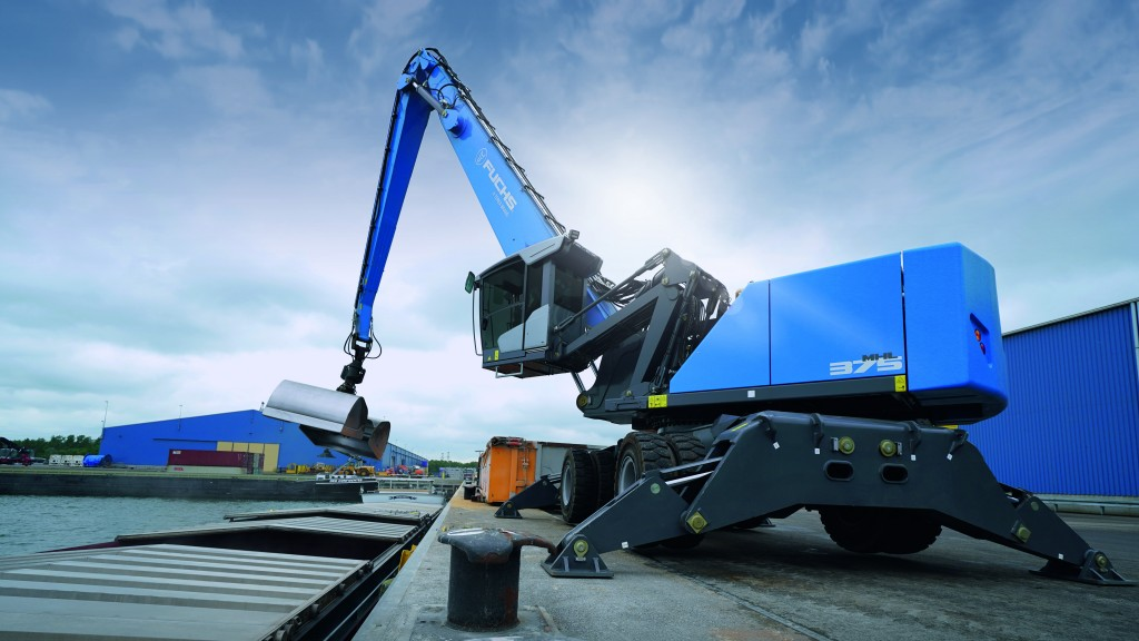The MHL375F material handler lifting a piece of metal