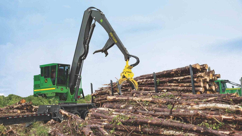 John Deere Knuckle boom loader in action