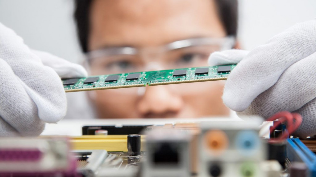 a man looks to place a circuit board