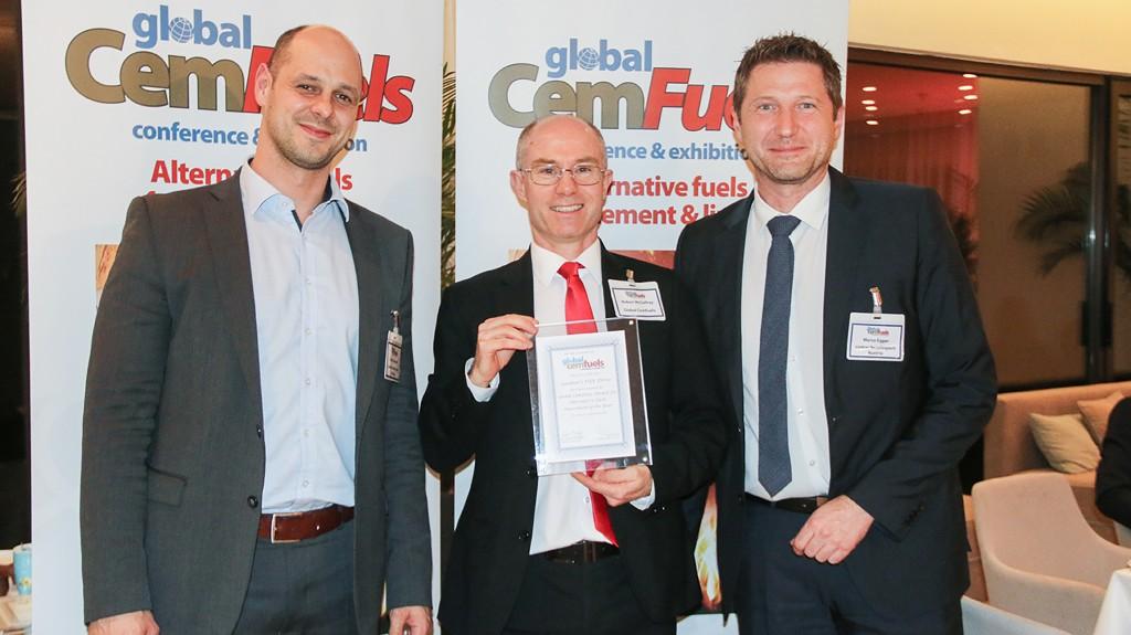 three men accept an award