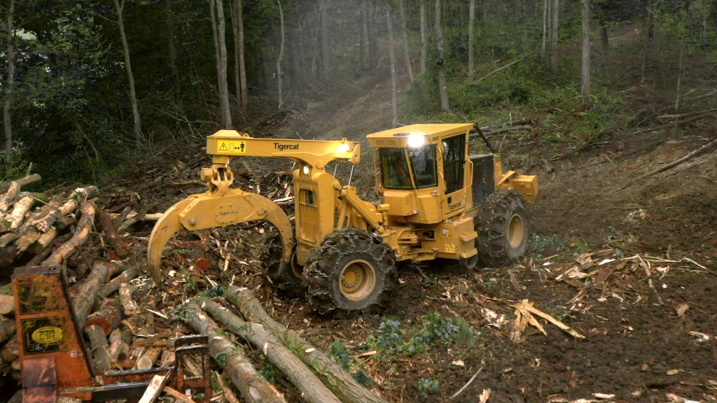 Tigercat 602 grapple skidder in operation in forest