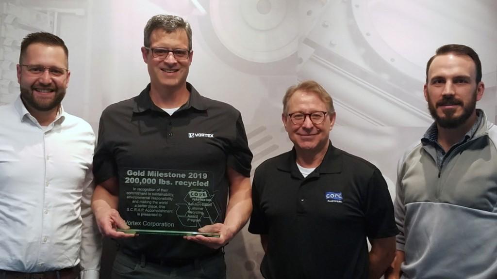 four representatives from Vortex receive plaque