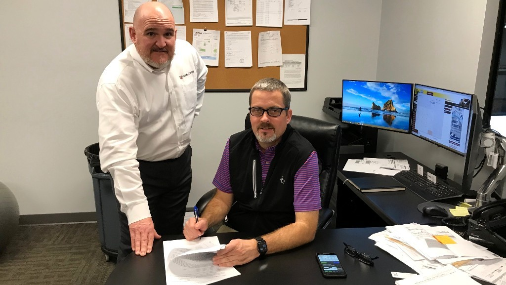 ​From left: Dan Meara, Regional Sales Manager at Terex Trucks, and Brett Arrowood, Managing Partner at Border Equipment, signed the dealer agreement.