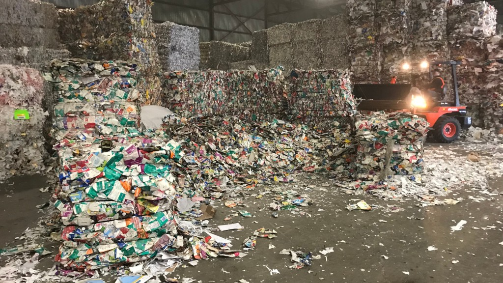 Inside Sustana paper mill baled cartons front