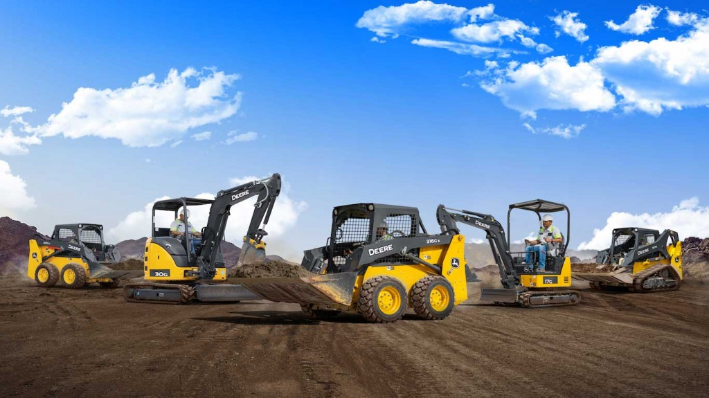 a collection of john deere machines on a site