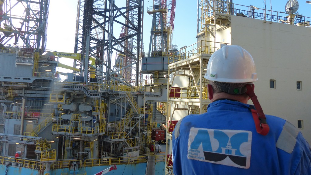 Aberdeen drilling consultant worker looks at tanker