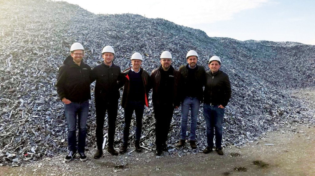 TOMRA team in front of Zorba pile